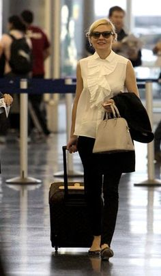 Kirsten Dunst with her LV Alma & luggage - don't leave home without it!