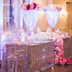 This head table stands out with a cascading floral arrangement in rich, romantic colors.