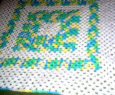 Baby Granny Afghan- White with blue, green, yellow and white variegated.