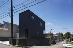 Completed in 2016 in Japan. Images by Mikiko Kikuyama             . The Black Box House, designed for an international fashion buyer and his family of four, sits in a hilly suburban residential district with detached...