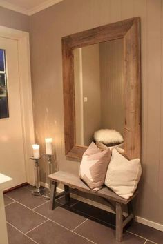 I like the large mirror small bench entry way idea