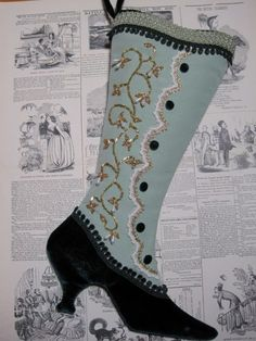 Made of Sage shantung & luxurious deep green velvet.  Trims highlight the curves of this shapely Victorian boot.  Beaded with a vine & drop floral motif. This stocking was made from the Lady...