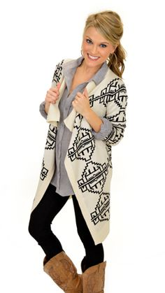 Everything about this cardigan is good! From the colors to the print you'll love it! Available today at shopbluedoor.com