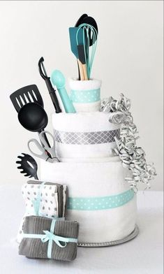 Towel Cake: A Fun DIY Bridal Shower Gift Wedding Gifts - A towel cake is a perfect DIY bridal shower gift idea that's easy to make, creative to give and a present the bride will love! Plus, we've got a great game you can play with this towel cake as well! Bridal Shower Gifts For Bride, Bridal Shower Cakes, Bridal Shower Party, Bridal Shower Decorations, Wedding Gifts, Kitchen Shower Decorations, Wedding Showers, Wedding Cakes, Wedding Ideas