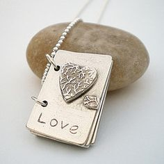 Book of family fingerprints in silver clay. Stamped Jewelry, Handmade Jewelry, Earrings Handmade, Fingerprint Jewelry, Purple Agate, Metal Clay Jewelry, Precious Metal Clay, Silver Work, Heart Jewelry