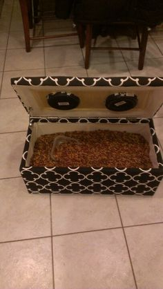 Dog food storage: I bought a kick butt storage chest from s local store and saw cut the food bowls