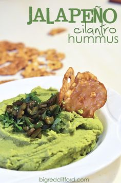 : jalapeno cilantro hummus : jalapeno cilantro hummus   1-2 Jalepenos  1 tablespoons minced garlic 1/4 cup lemon juice 1-2 tablespoons olive oil  2 cans chickpeas 1/4 cup sesame tahini {in the peanut butter section, or the health food section of most stores- vital to the recipe} 1 teaspoon cumin 1 cup cilantro  salt & pepper to taste