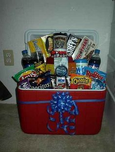 Cooler Gift Basket Idea ~ Place some crumpled paper in the bottom of the cooler to provide some height, then fill it up... Great gift idea for anytime!