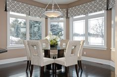 Using a valance is an excellent way to draw the eye upward. The valances in this dining nook help the space feel large and open. They allow the contemporary chairs to stand out, and perfectly frame the light fixture.