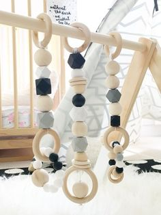 For the mini modern minimalist, our wood and silicone baby gym toys and activity center are made from 100% food grade silicone and all natural non-toxic and antibacterial beech wood free of BPAs, lead