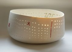 pierced porcelain bowl. I love this artist's work very much - apologies, but I don't have the maker's name.