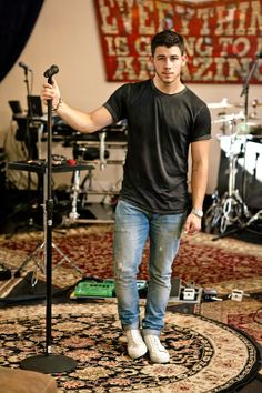 Nick Jonas. Black top, denims, canvas shoes. Perfect.