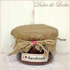 Caramel sauce with pecans..what I love is the rough-edged burlap and twine wrapped jar...great recipe, too