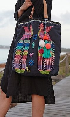 Neon Bird Tote, navy cotton tote with neon Aztec bird embroidery and fabulous tassel charm.