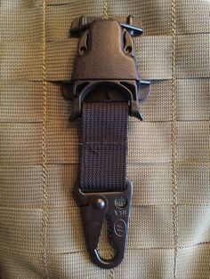 * Great for attaching gas mask carrier, leg / thigh panels, dummy       cords, or a Carabiner     * REMOVABLE MALE wolf hook System, Designed to provide extra mounting       points on MALICE / PALS surfaces     * Every Which Way Buckle adapter mounts to MALICE / PALS webbing     * It is fully compatible to MALICE / PALS, FSBE, FSBE II, SPEARS,       BALCS, MLCS, & CIRAS systems     * Constructed of mil-spec webbing and all plastic hardware are       formulated to pass the military require...