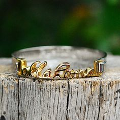 Gold script word choices top this silver stainless steel bangle and an everyday reminder of what's important.