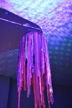 Cool blacklight streamer chandelier, perfect for a shroom room