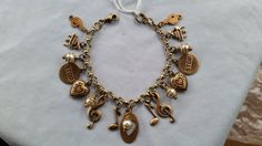 Music themed charm bracelet with brass hearts by LeilaBeeDesigns