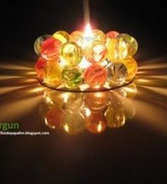 Candle holder with marbles