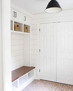 Mudroom brick flooring and shiplap walls. The designer used old Chicago bricks for the floor. Mudroom Paint Color: Farrow and Ball Wimborne White. Luxury Interior Design, Interior Design Inspiration, Design Ideas, Floor Design, House Design, Brick Flooring, Penny Flooring, Ceramic Flooring, Garage Flooring