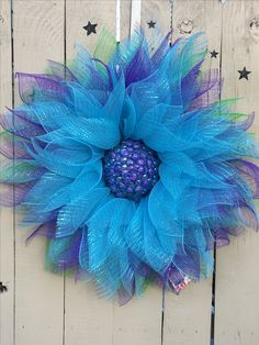Mesh flower wreath. Peacock colors. Jewel center