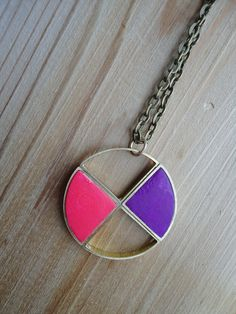 Pink and purple circle with gold tone brass pendant necklace