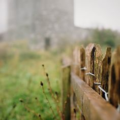 ballyportry bokeh  Happy Fence Friday! It's been a while since I've scrounged up a fence to post. This was taken in Ireland, and that's Ballyportry Castle in the background. I spent an hour or two one morning just wandering around the immediate castle grounds. By the time I was finished my pants were soaked in dew and I had cobwebs all over me, but I was happy...by manyfires...Flickr.com