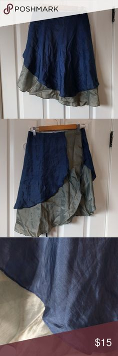 "100% Thai silk wrap skirt. Vintage blue & silver Vintage beautiful 100% Silk skirt from Thailand. The skirt is a wrap skirt with an enchanting drape. Size is small to be worn for best coverage, but total waist measurement is 37"" (since it's a wrap skirt) could fit up to a medium if you wore leggings underneath. It has an asymmetrical fit but at largest length is 24"" from waistband to hem. Skirts Asymmetrical"