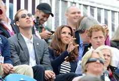William and Kate seemed to be distracted by something up above whilst Harry concentrated on the event. Kate chose the same £500 navy blazer by Smythe as yesterday, this time teaming it with a chic Breton striped top