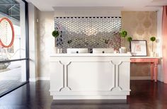 Reception desk, nice millwork detail. Clean yet sophisticated