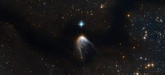 This new Hubble image shows IRAS 14568-6304, a young star that is cloaked in a haze of golden gas and dust. It appears to be embedded within an intriguing swoosh of dark sky, which curves through the image and obscures the sky behind.