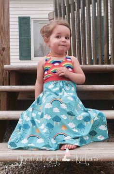 Who wouldn't want their mini-me to wear a dress similar to their own beloved Brazi? This dress is like the Brazi in that it has three beautiful looks in one including crop top or dress with knee or maxi length. You have the same skirt style and cross-back bodice. The Aurora pattern is designed for children so the waistband falls lower than the Brazi, at the natural waist, and the bodice is just barely snug. Your little darling will love to dress like mommy but in a more modest way.