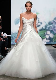Gown features lace and corset bodice. Silhouette: Ball Gown Neckline: Strapless Waist: Dropped Gown Length: Floor Train Style: Attached Train Length: Sweep Fabric: Reembroidered Lace, Satin, Tulle Embellishments: Color: White or Ivory Size: 2 - 14 Price: $$$$$