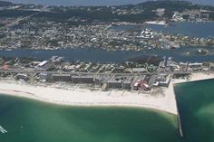 Aerial image of the Perdido Pass jetties.  Click the link to visit our website and view current Orange Beach, AL homes for sale.  http://www.condoinvestment.com/orange-beach-al-subdivisions.php