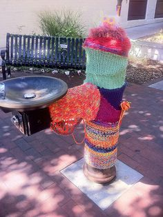 guerilla knitting. Traverse City Michigan Some people apparently love it.  I want to release a gang of feral cats on the yarn.