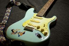 Vintage Fender Strat from the early sixties in sonic blue, turned more greenish due to ageing.