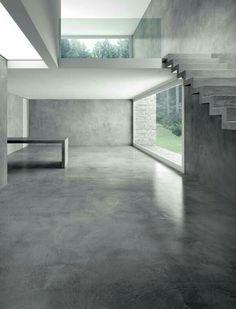 Espacio habitacional hecho en su mayoría con concreto pulido en color gris. Me gusta la intención que es hacerlo un lugar algo industrial ( por los materiales usados ) y no por el espacio utilizado.