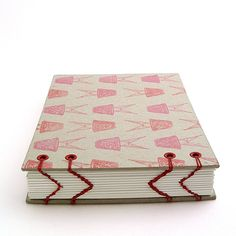 A view of chevron bookbinding - coptic stitch variation with hand stamped pattern on raw bookboard  bookbinding by Ruth Bleakley