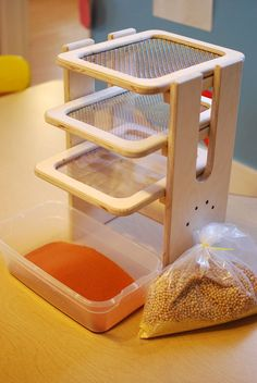 Sift and Sort-The tower consists of three different sized screens, each of which filter out a different sized material. Children pour a mixture of materials in the top and the material is sorted by size, large medium and small. Screens slide in and out of the tower and can be used individually for closer examination.