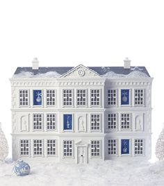 The world's most exclusive Advent calendar, from Harrod's and Wedgwood. Each window of this hand-crafted Georgian manor contains a porcelain ornament of white and Wedgwood blue.