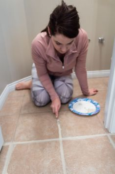 Make your tiled floor look brand new again! This tutorial has the easiest tips and tricks to paint your tile grout with just a few simple steps. Avoid the hassle of cleaning your dirty grout lines and find the best paint products to freshen up your grout. Grout Paint, Sanded Grout, Tile Grout, Grout Repair, Easy Tile, Ceiling Trim, Painting Tile Floors, Brick Fireplace Makeover, Throw In The Towel
