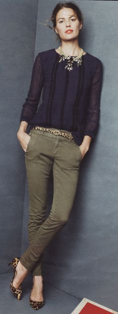 Dig the olive pants with black top, statement necklace & animal print shoes.