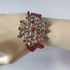 This is a pretty, 6 strand, silver tone, bead bracelet. is still a pretty nice bracelet. 1920s Flapper Costume, Silver Filigree, Blue Beads, Bangle Bracelets, Flower, Pretty, Red, Bracelets, Floral