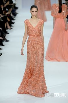 Elie Saab - Alta Costura - Primavera-Verano 2012 - Brenda Kranz - http://es.flip-zone.com/fashion/couture-1/fashion-houses/elie-saab-2529 - Coral pink fully embroidered dress with V neckline, drape detail at back with bow leather belt. © Pixelformula
