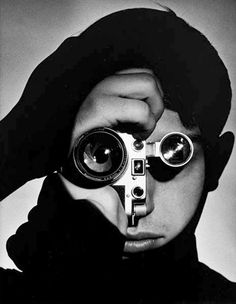The Photojournalist by Andreas Feininger, wikipedia: This iconic portrait of Magnum photographer Dennis Stock holding a Leica SM vertically and looking through a separate TEWE viewfinder became so identified with photojournalism that it was used by LIFE for the cover of their book, 'What They Saw'. http://iconicphotos.wordpress.com/2009/07/06/the-photojournalist/ #Portrait #Photojournalist #Andreas_Feininger