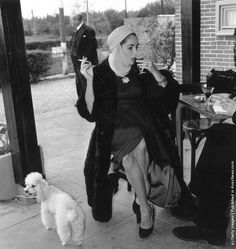 American actress Elizabeth Taylor sips a drink and smokes a cigarette during a stop for interviews at Jersey airport en route to Nice. (Photo by Stanley Sherman/Express/Getty Images). 23rd April 1957