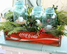 Beach Christmas Jars. Fill blue mason jars with sand and place candle inside, arange in a box or crate with evergreens. Lovely! Featured on CC: http://www.completely-coastal.com/2013/12/Christmas-jars-beachy.html