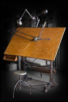 Vintage iron drafting table and stool with its original drawing arm and industrial light. Made by Oldor of Barcelona, Spain.