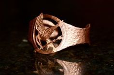 Hunger Games inspired jewelry.