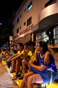 Celebs and fans show their support for Neymar----Brazil football fans sit outside Sao Carlos Hospital where superstar striker Neymar was treated after being injured during the quarter-final football match between Brazil and Colombia at the Castelao Stadium in Fortaleza during the 2014 FIFA World Cup on July 4, 2014.